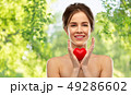 beautiful smiling woman holding red heart 49286602