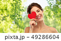 beautiful smiling woman holding red heart 49286604