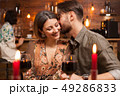Young man kissing his fiance on a night out 49286833
