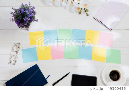 Message at colorful note papers on a desk background. 49300456