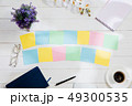 Message at colorful note papers on a desk background. 49300535