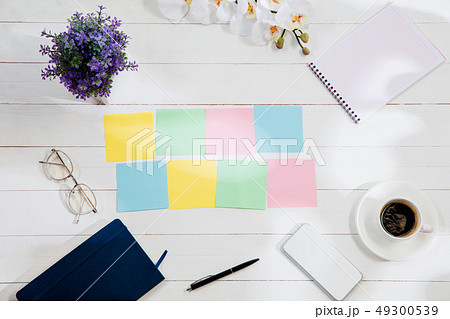 Message at colorful note papers on a desk background. 49300539