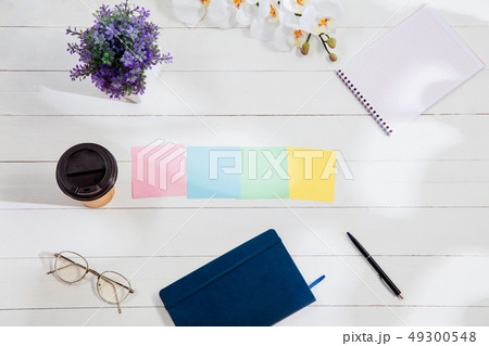 Message at colorful note papers on a desk background. 49300548