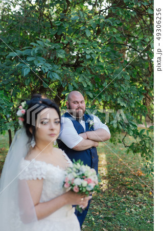 Newlyweds on their wedding day stand apart from 49306256