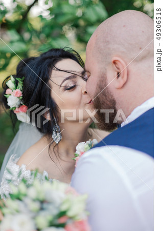Newlyweds on their wedding day are walking in the 49306518