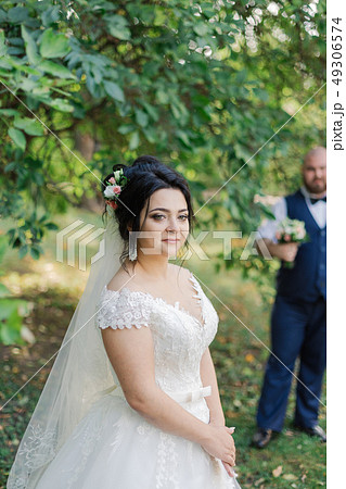 Newlyweds on their wedding day stand apart from 49306574