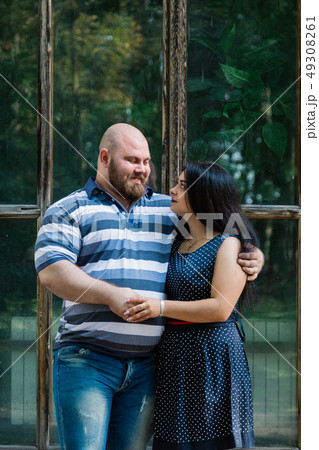 Two people in love stand hugging by large windows 49308261