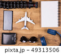 Flat lay top view of traveler accessories on wooden background 49313506
