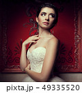 Gorgeous bride in wedding dress in vintage interior 49335520