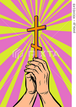 Christian Orthodox cross in the light, the hands of the believer 49340149