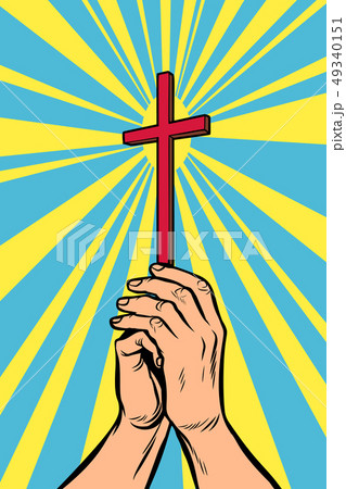 Christian cross in the light, hands of the believer 49340151