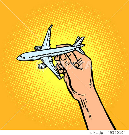 passenger plane in hand. metaphor of travel and tourism 49340194