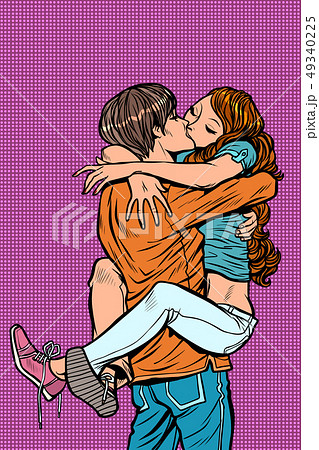 couple in love hugs passionate kiss. man holding woman in his arms 49340225