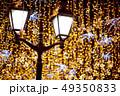 Street lantern with decorative Christmas garlands. 49350833