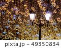 Street lantern with decorative Christmas garlands. 49350834