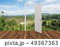 Landscape behind the opening door 49367363
