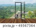 Landscape behind the opening door 49367364