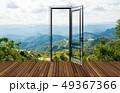 Landscape behind the opening door 49367366