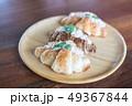 Croissant with Tuna Salad  Sandwich on wood table 49367844