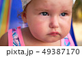 close-up, portrait of a little one year old babe on the beach. 49387170