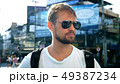 Bearded young man in sunglasses standing on the road. Taxi concept 49387234