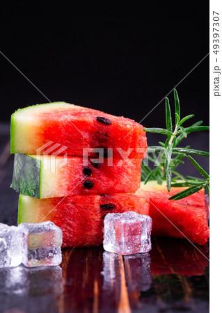 watermelon on wooden background 49397307