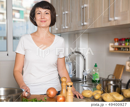 Woman standing at kitchen 49400927