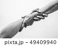 Help hands holding together in monochrome 49409940