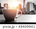Cup of coffee on wooden table in cafe 49409941