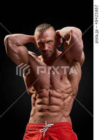 Handsome man with big muscles, posing at theの写真素材 [46118011] - PIXTA