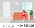 Girl sitting on the sofa 49456486