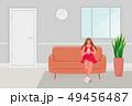 Girl sitting on the sofa 49456487