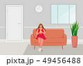 Girl sitting on the sofa 49456488