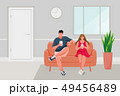 Man and Girl sitting on the sofa 49456489