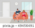Man and Girl sitting on the sofa 49456491