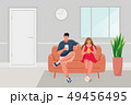Man and Girl sitting on the sofa 49456495