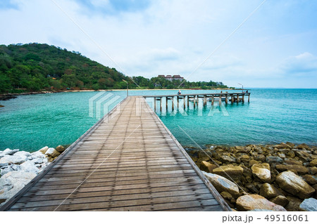 Wood bridge in to the sea 49516061