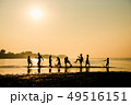 Silhouette of children playing water with friend 49516151