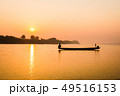 Fishermen in the boat on sunrise background 49516153