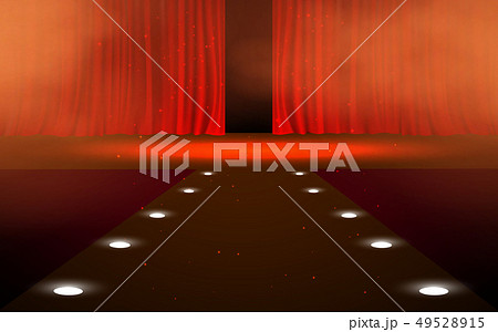 Red curtain with spotlight on the stage 49528915