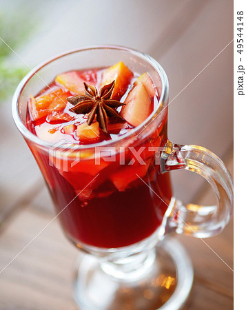 Glass of mulled wine with grapefruit, orange 49544148