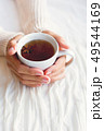 Women holds a cup of hot tea with anise star. Cozy 49544169