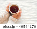 Women holds a cup of hot tea with anise star. Cozy 49544170