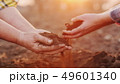 Two farmers hold handfuls of soil from the field. Organic farming concept 49601340