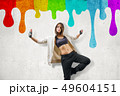 Street dance young girl dancing on rainbow colorful wall background 49604151