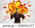Young man in casual clothes making brain explosion gesture with cartoon explosion drawn on white 49604157