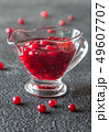 Cranberry sauce in glass gravy boat 49607707