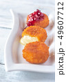 Camembert nuggets with cranberry sauce 49607712