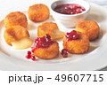 Camembert nuggets with cranberry sauce 49607715