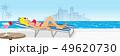 長椅子に寝そべるビキニの女性 プールサイド、コピースペースあり 49620730